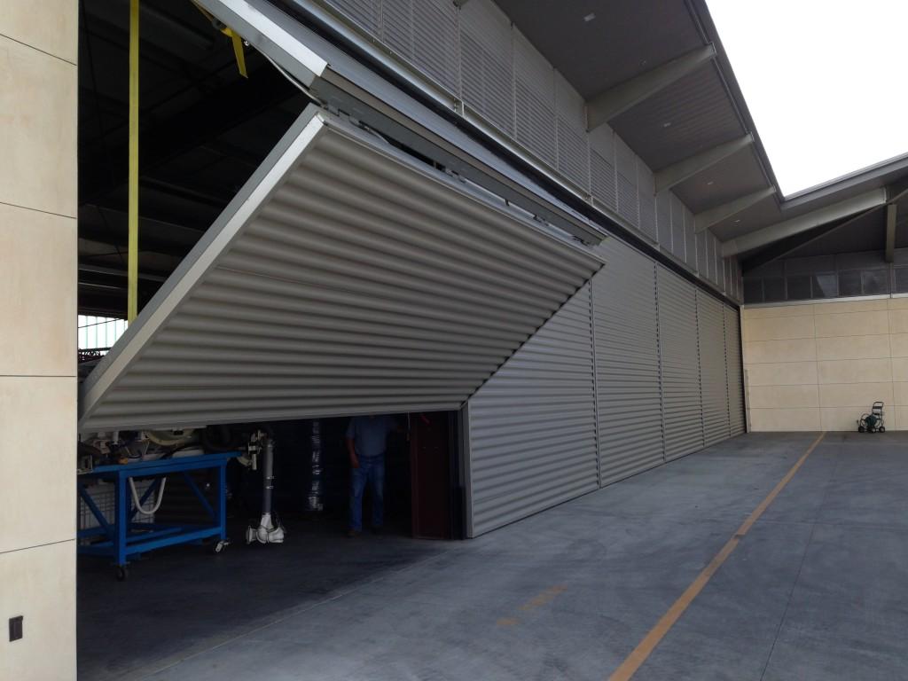 Six Schweiss Lift Strap Bifold Door On Opus One Maintenance Building
