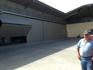 Juan standing outside in the courtyard with schweiss bifold door opening up