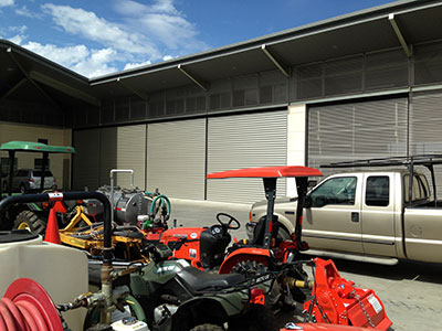 A Picture of all Equipment to make the winery operate in front of the schweiss bifold door