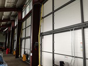 A view of the inside of schweiss lift strap bifold door built to last.