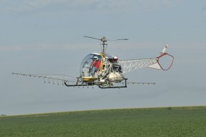 Flying evenly and steady over a field to deliver precise spraying patterns is an advantage of a helicopter.