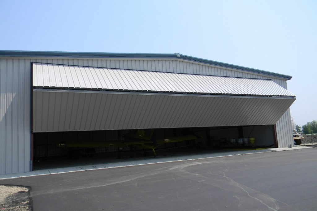 Time is money for aerial crop sprayers. Two large 65 ft. bifold doors on this hangar can be opened by remote control by the pilot.