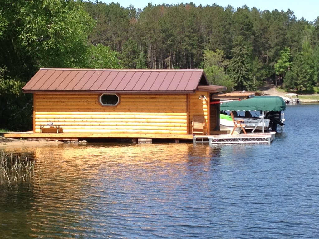 Hydraulic or bifold remote opening boathouse doors make docking your watercraft easy in all types of weather