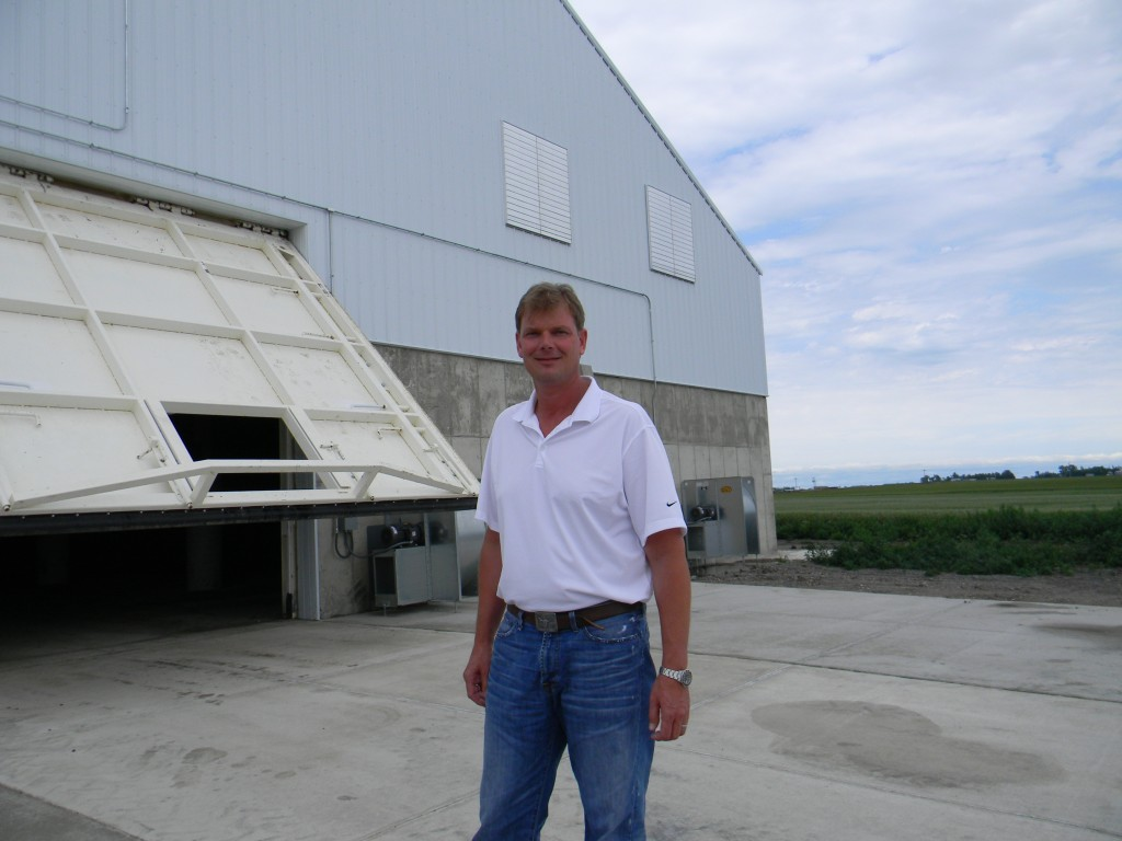 Grain storage hydraulic doors work as bunker walls for corn storage with zero leakage.