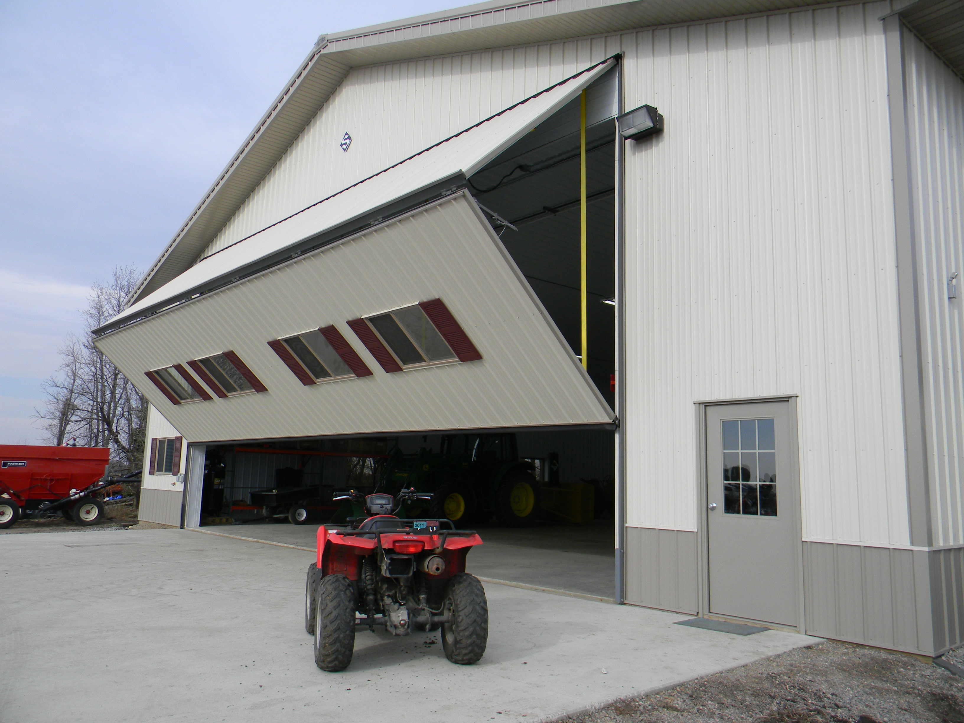 Farmers and ranchers rely on Schweiss doors for machine sheds to store large machinery. & Schweiss Doors has long been the farmersu0027 friend | Schweiss Bifold ...