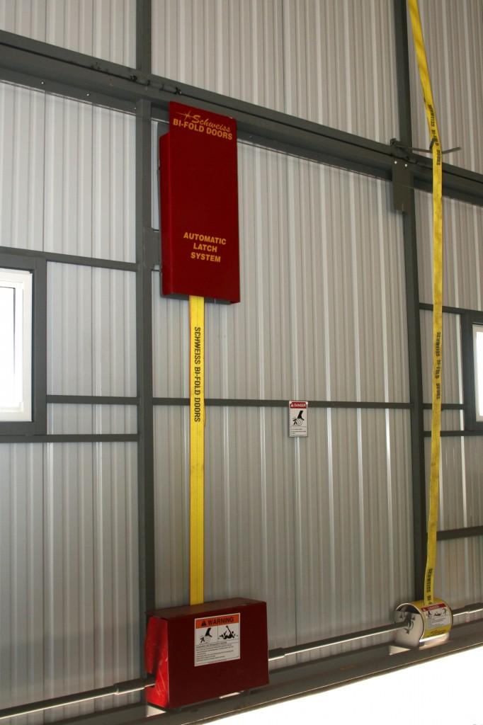 Schweiss Latch strap on a bifold door