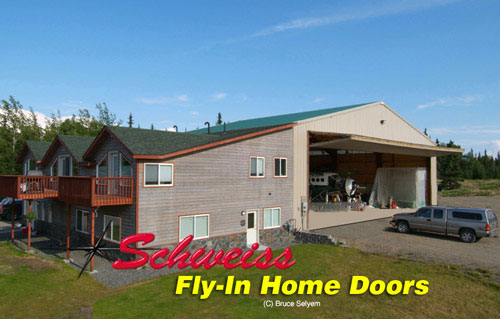 Airpark photos airplane hangar doors for fly in home for Flying haus