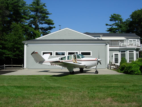 Plane Sitting in Front of Airpark Home
