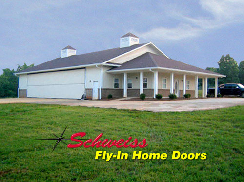 Airpark photos airplane hangar doors for fly in home for Aircraft hangar home designs