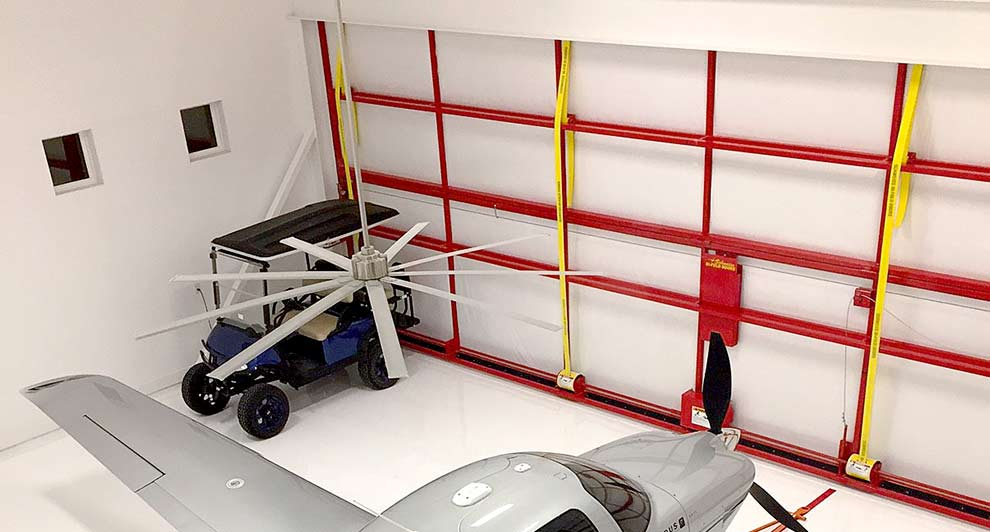 airplane hangar doors with auto arm latch