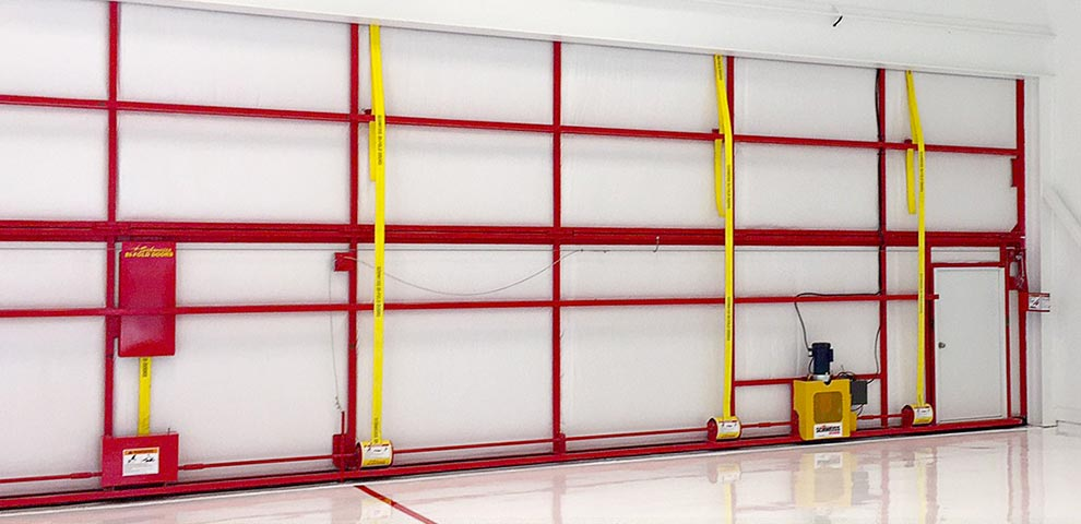 Yellow Lift Straps on Bifold Hangar Doors