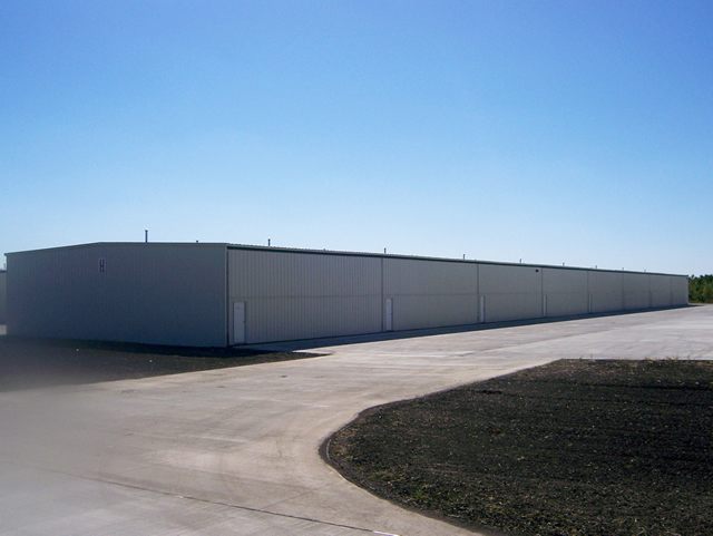 row of t-hangars with bifold doors
