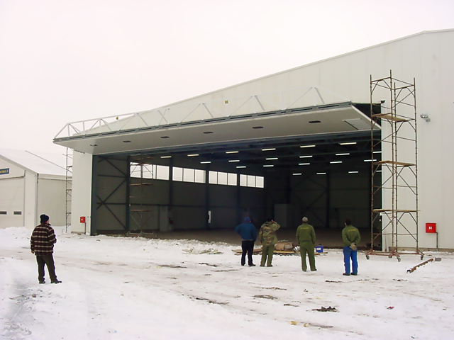 large bifold door on aircraft hangar in europe