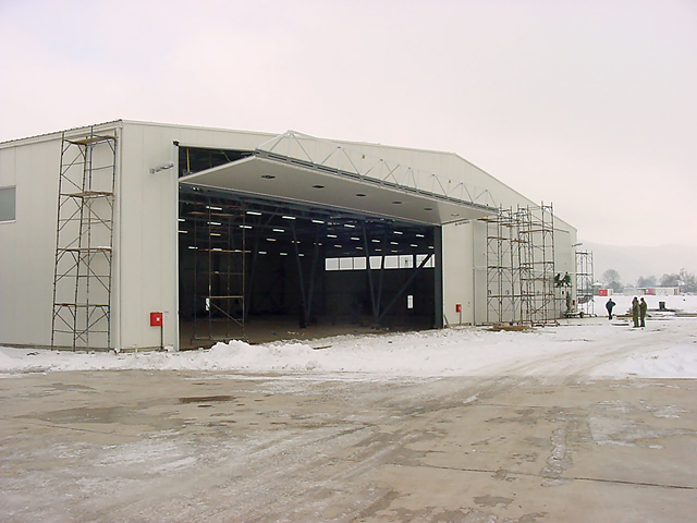 bifold door in full open position on european aircraft hangar