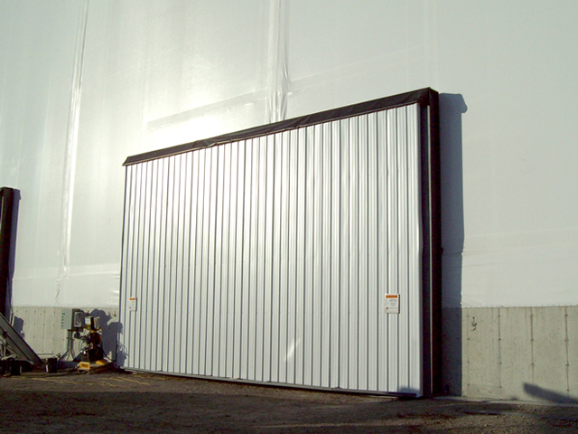 hydraulic door in end wall of fabric building & Schweiss Doors on Fabric Buildings of Various Shapes and Sizes ...