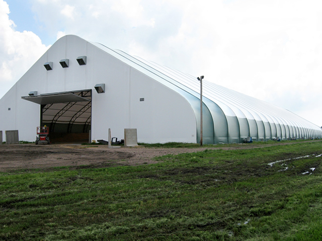 large fabric building with open bifold door