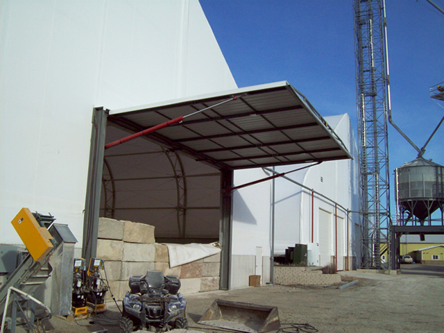 side view of open hydraulic door on fabric building