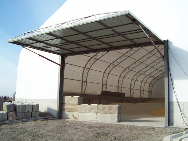 fully open hydraulic door on fabric building endwall