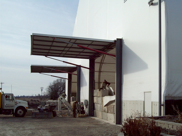 twin hydraulic doors on fabric building endwall in open position