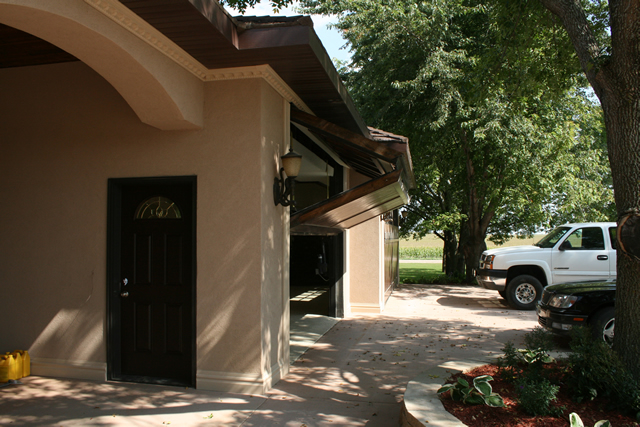 Two bifold garage doors with wood paneling