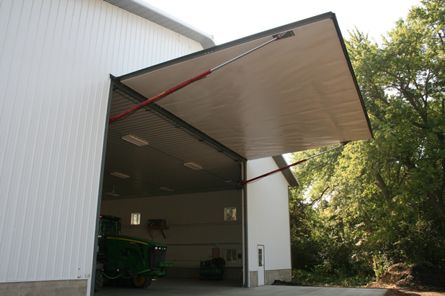 Hydraulic door opens on farm building