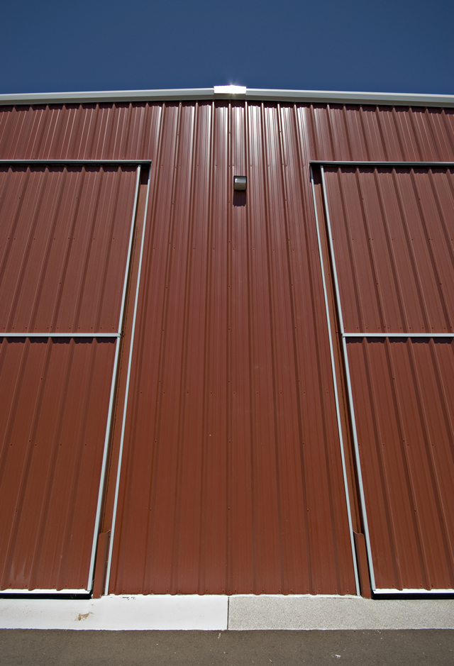 close up of twin bifold doors on steel building