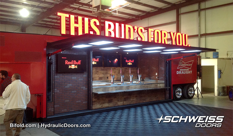 Schweiss Hydraulic Doors on Trailer provide Awning when open