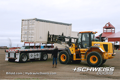 Machinery placing container on Semi Trailer