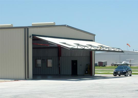 Personalized hangar door comes with windows for natural Lighting