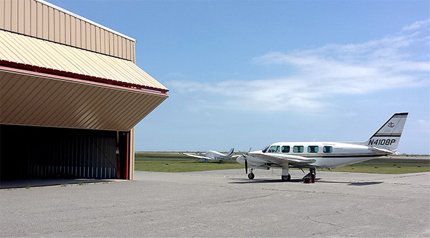 Nantucket island bifold hangar door opens up for commuter planes to the mainland