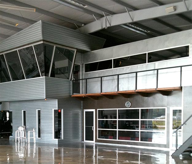 Spring, Texas hangar with 78' x 18' Schweiss Hydraulic Door with large Plexiglas Window