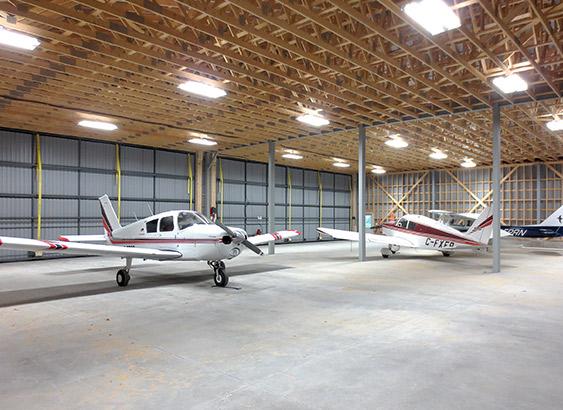 large hangar has two Schweiss Bifold doors with patented lift straps