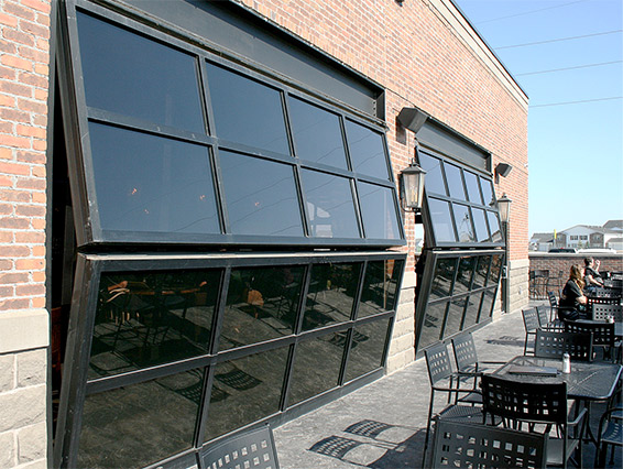 Irish pub connects to out and in doors with three 19' by 7' bifold glass doors. The patio has room for 70 more people.