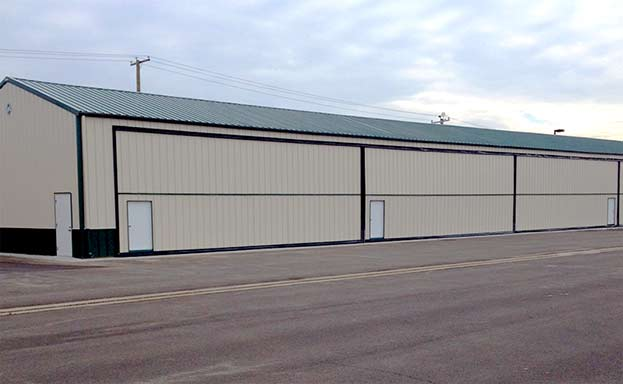 40' x 14' schweiss bifold liftstrap doors are installed with autolatches in Conneticut