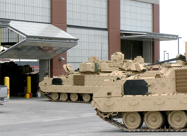 Schweiss Bifold Doors installed at Fort Carson allow tanks to travel through more than 140 different doors