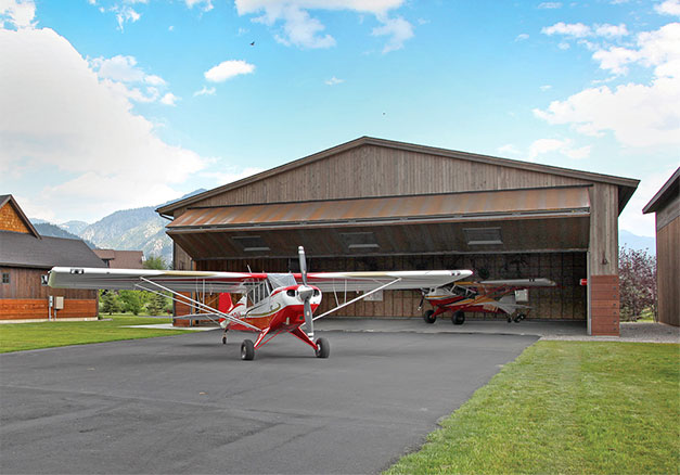 Unique hangar in Alpine Airpark matches scenic backdrop