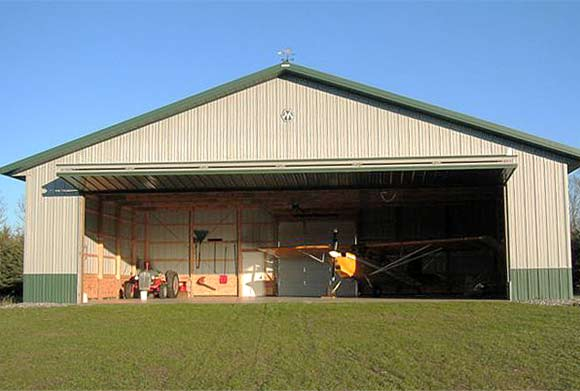 North Carolina helicopter hangar door matches look of Carriage House