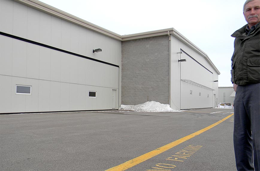 clean 48 foot bifold hangar door at airport in Minnesota