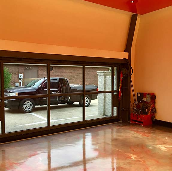 high ceiling in garage gives room for stackable two-car lift