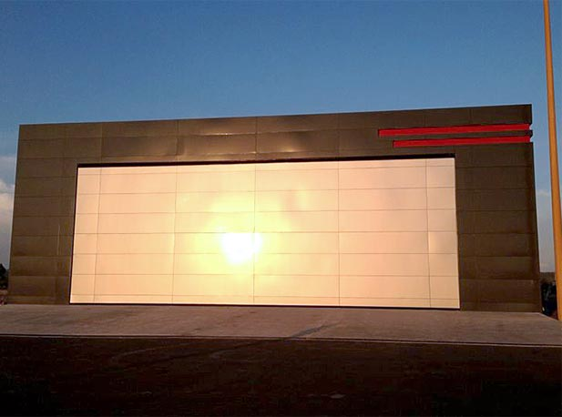 Sun reflects off of exterior of Schweiss bifold hangar door