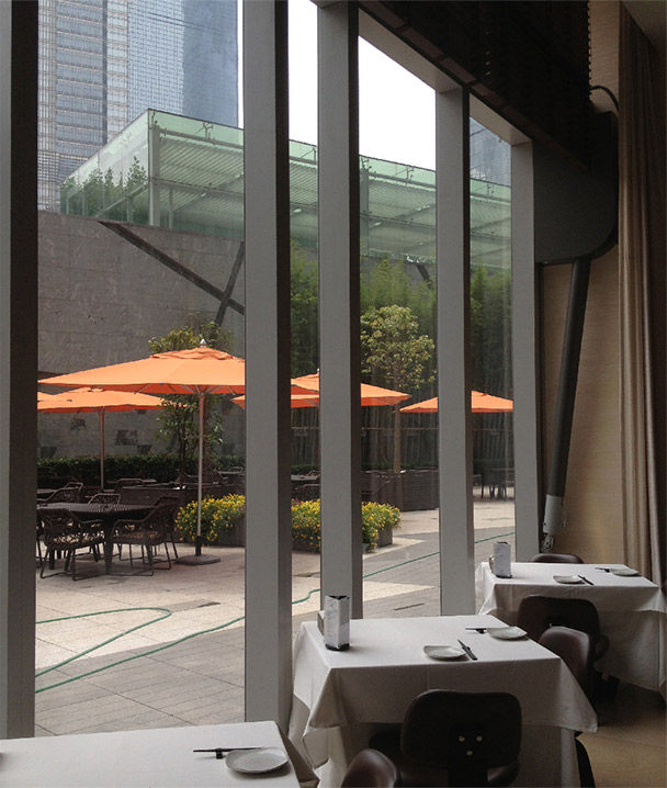 plaza level restaurant has glass designer doors fabricated with galvanized steel