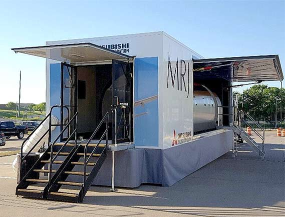 Mobile Container with prototype fuselage inside has Schweiss One-Piece Hydraulic Door