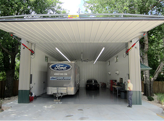Schweiss One Piece Hydraulic Door opens up to trailer and car