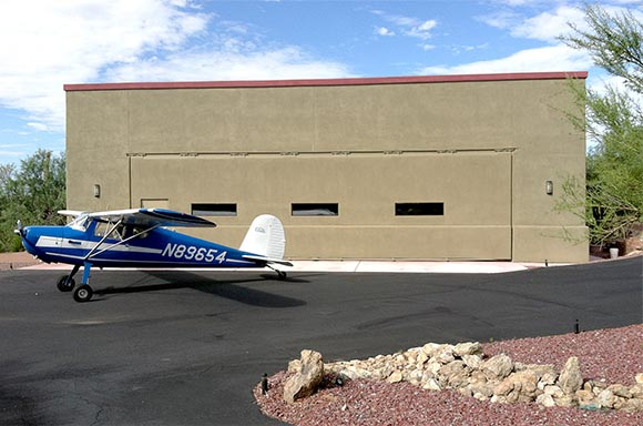 44 x 12 Schweiss hydraulic hangar door gives room to move around Cessna 140