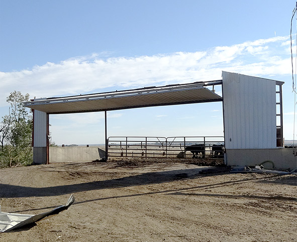 Schweiss Bifold Liftstrap at end of cattle barn is the only thing standing