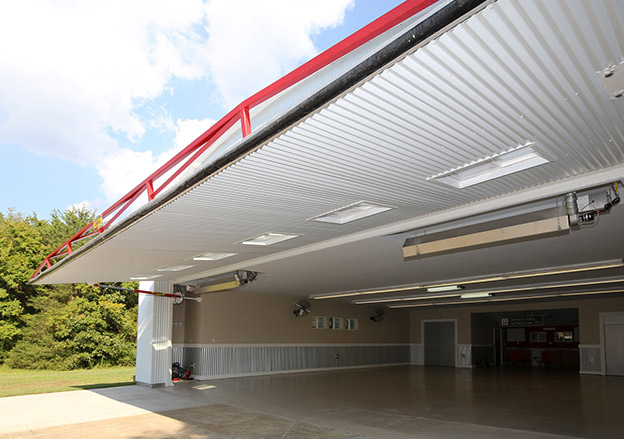 Schweiss One-Piece Hydraulic Door provides a nice shaded canopy and showing off overhead infrared heaters