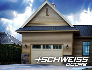 Bifold Designer RV Garage Door has seamless look with matching siding of garage