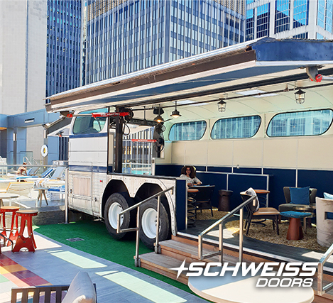 Bobby Hotel Calls Schweiss Doors to open Bobby Bus on the Roof