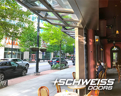 Atlanta, GA's Cafe Intermezzo have hurricane wall pins, manual latching systems and top-drive electric motors
