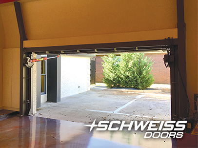 Glass Designer Hydraulic Garage Door matches the immaculate flooring